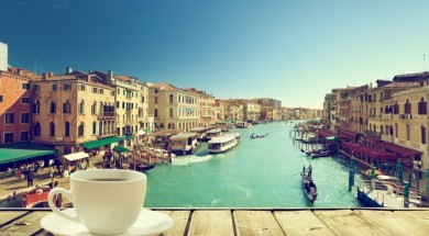 Wenecja coffee on table and Venice in sunset time, Italy