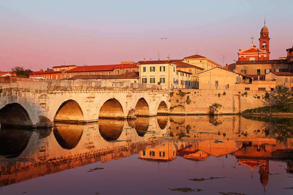 rimini Tiberius' Bridge at sunset. Rimini, Italy